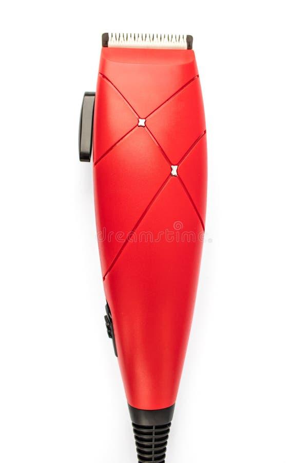 Röd hårclipper på en vit bakgrund royaltyfri bild