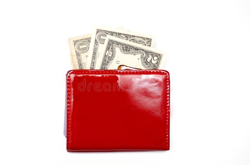 Röd handväska med pengar på en vit bakgrund royaltyfria foton