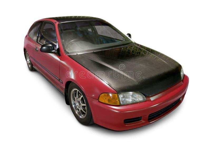 Röd Hatchback som isoleras på vit royaltyfri bild