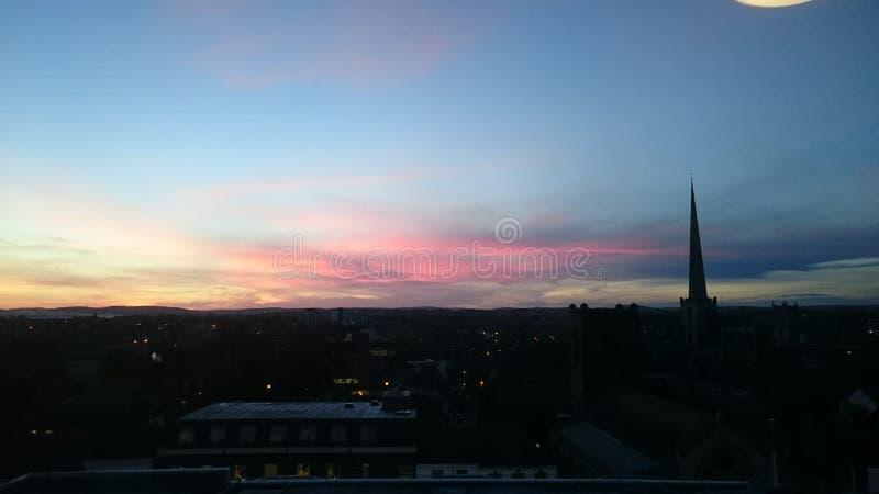 Röd himmel för solnedgång royaltyfria foton