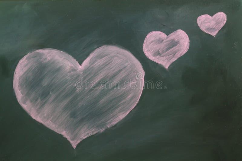 Röd hjärta i krita royaltyfria bilder