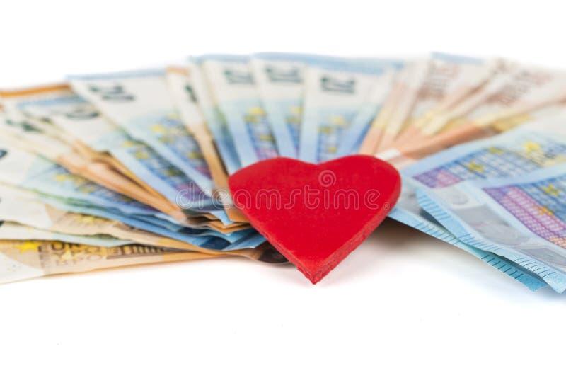 Röd hjärta med euro euroen bemärker reflexion älska pengar arkivbilder
