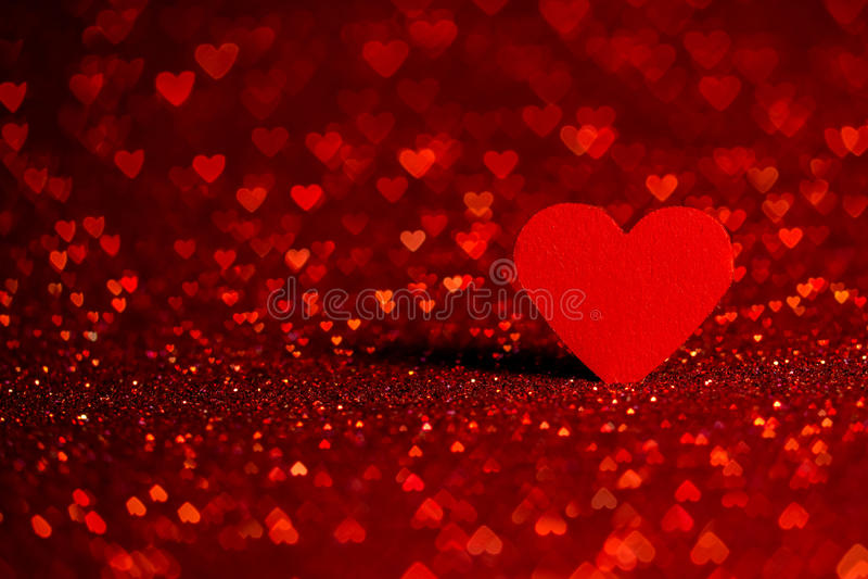 Röd hjärtabokehbakgrund Valentindagtextur arkivfoto