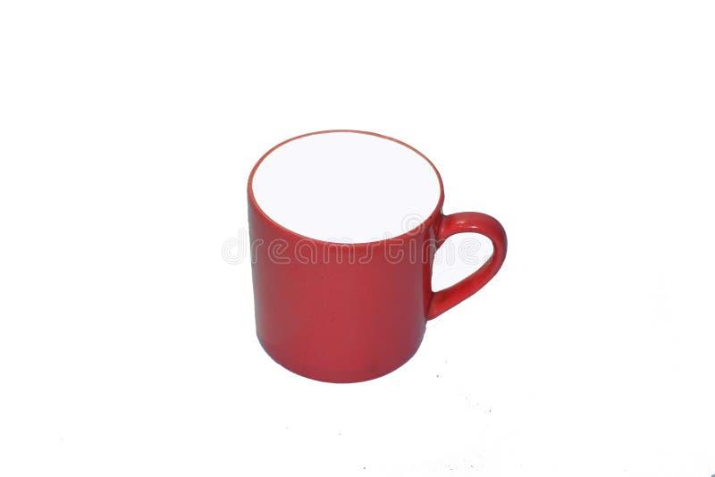 Röd isolerad tekopp med vit bakgrund royaltyfri foto