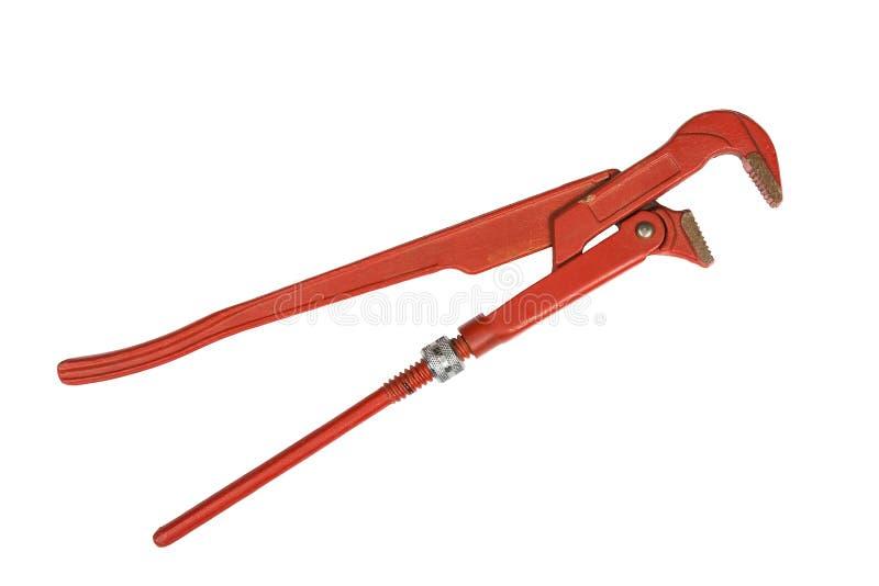 Röd justerbar rörskiftnyckel som isoleras på en vit royaltyfri bild