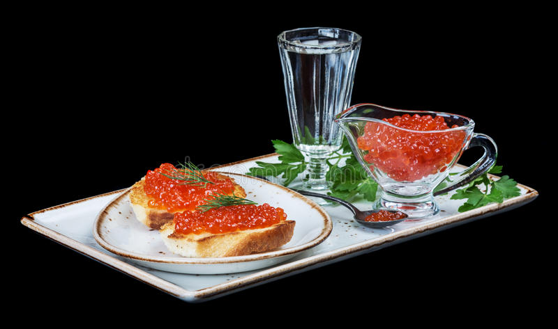 Röd kaviar och av vodka royaltyfri bild