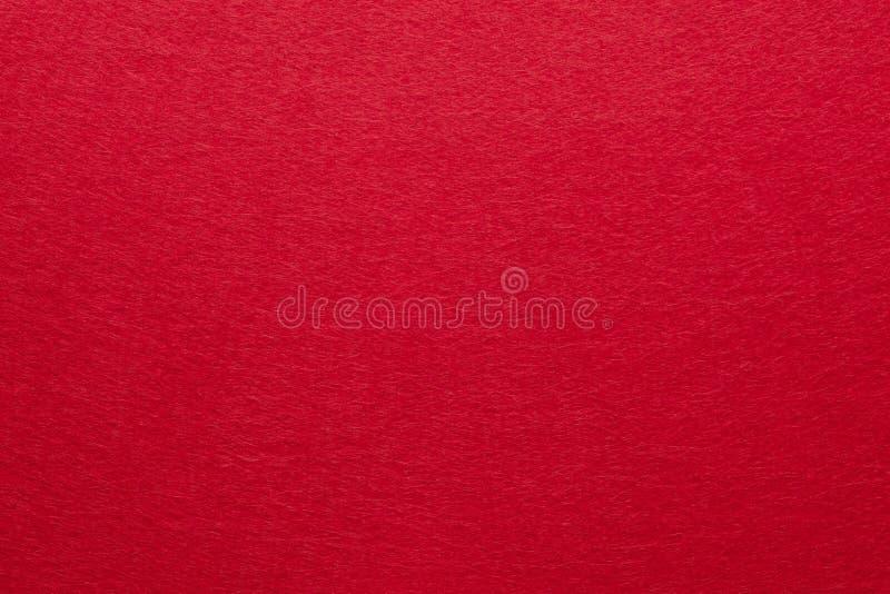 Röd klädd med filt bakgrund som är användbar för julbakgrunder arkivbild