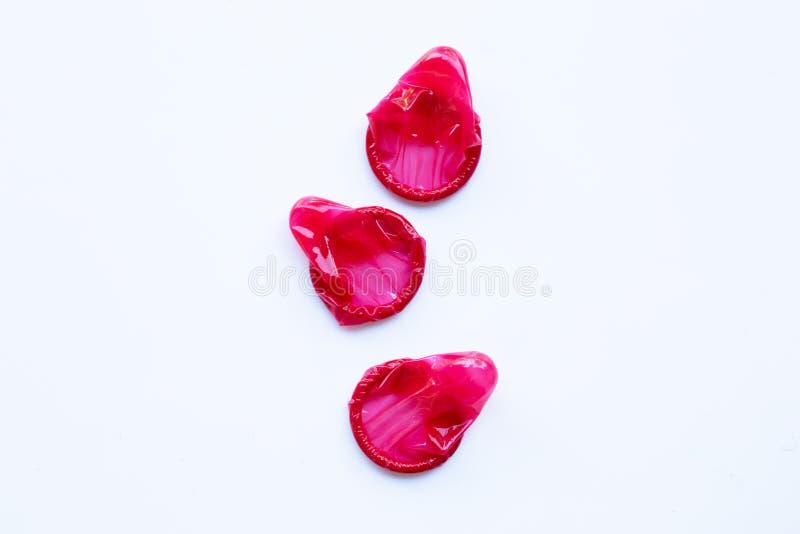 Röd kondom på ett vitt royaltyfri fotografi