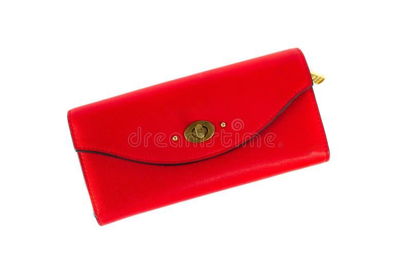 Röd kvinnlig plånbok som isoleras på vit bakgrund arkivbild
