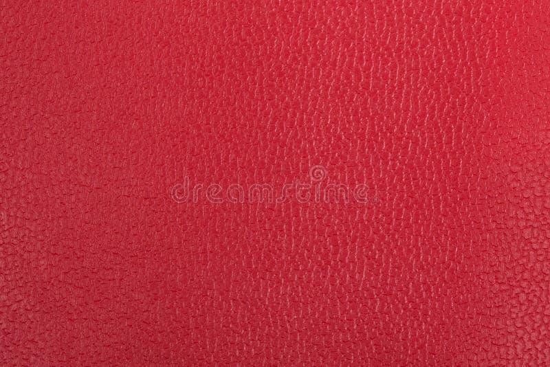 Röd läderbakgrund arkivfoton