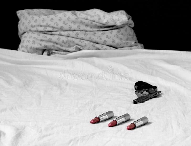 Röd läppstiftsäng arkivfoto