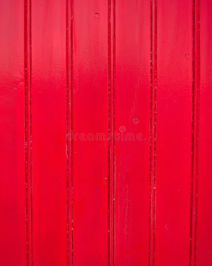Röd målad wood bakgrund royaltyfri foto