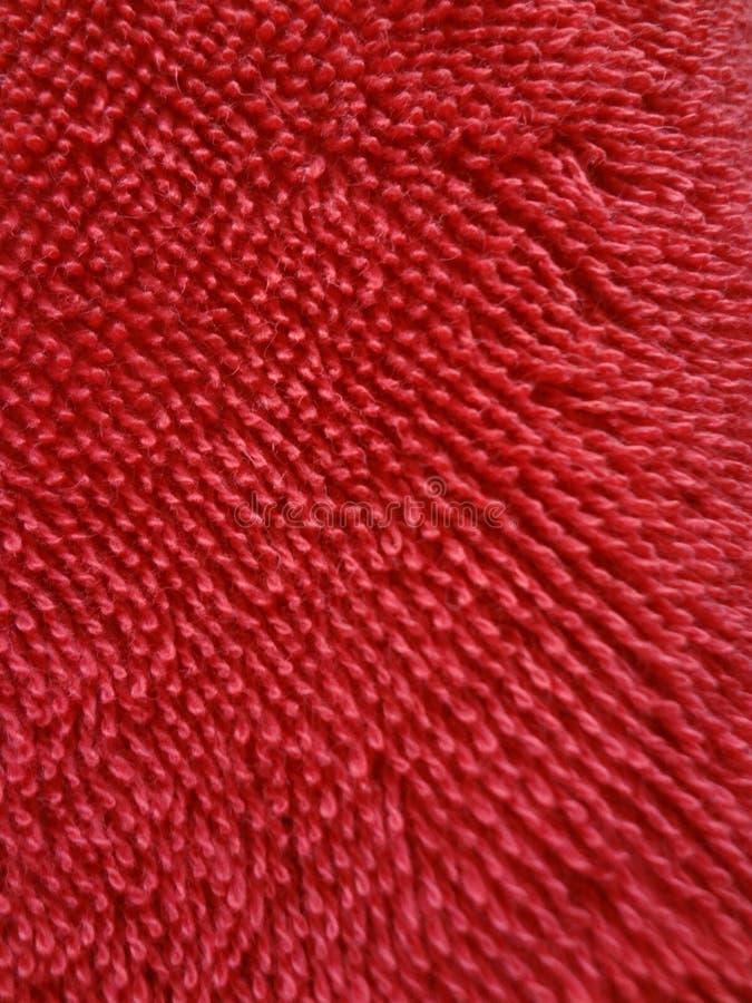 Röd macromateria för slut för bakgrund för frottéhandduk en förälskelse arkivfoton