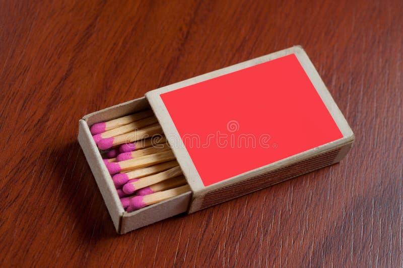Röd matchask fotografering för bildbyråer