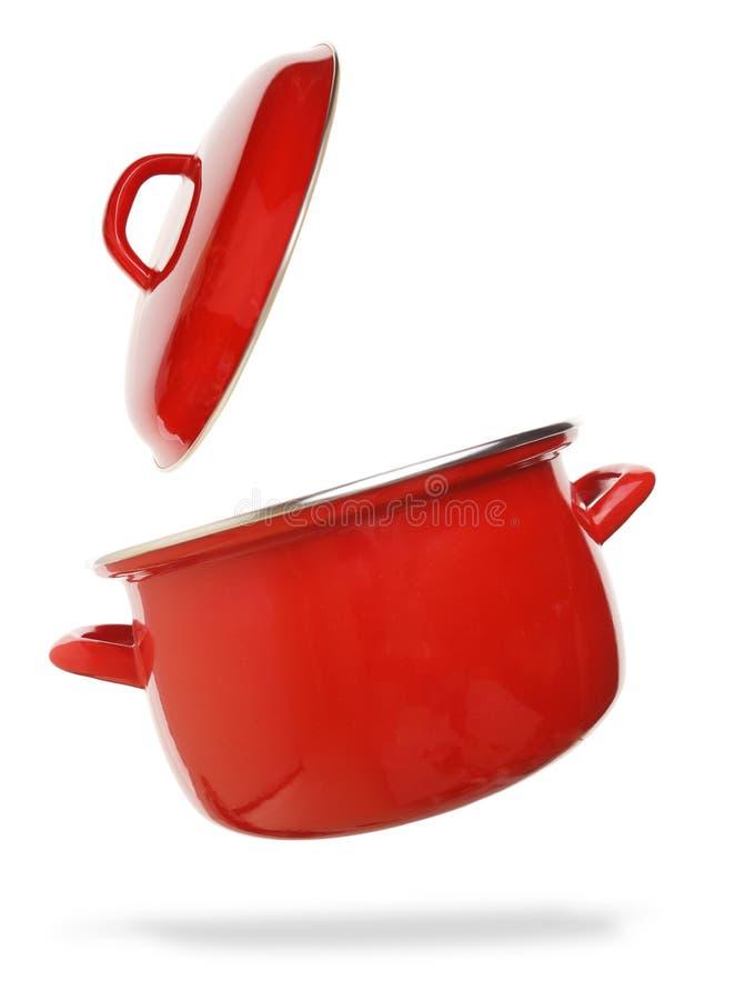 Röd matlagningkruka arkivfoton