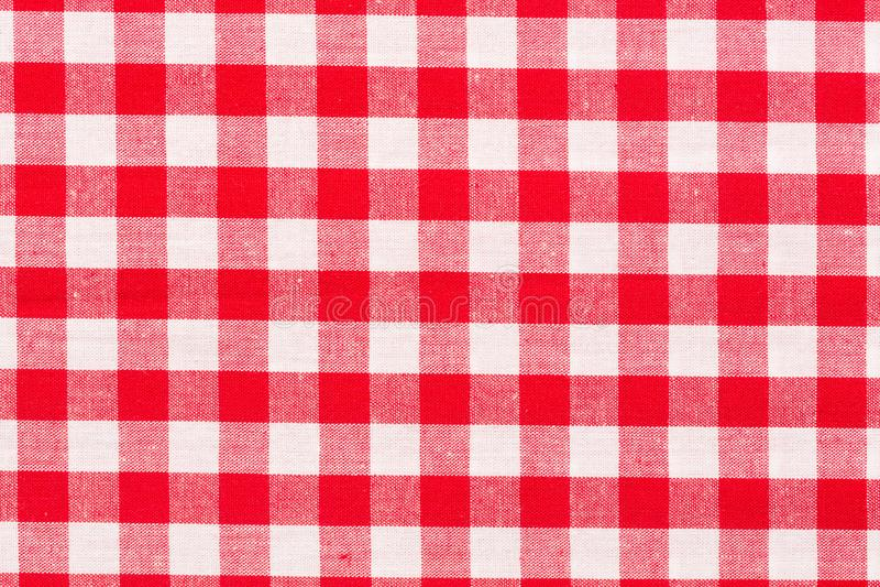 Röd modell för borddukbakgrund på makro Rutig picknickmatlagningbordduk arkivfoton