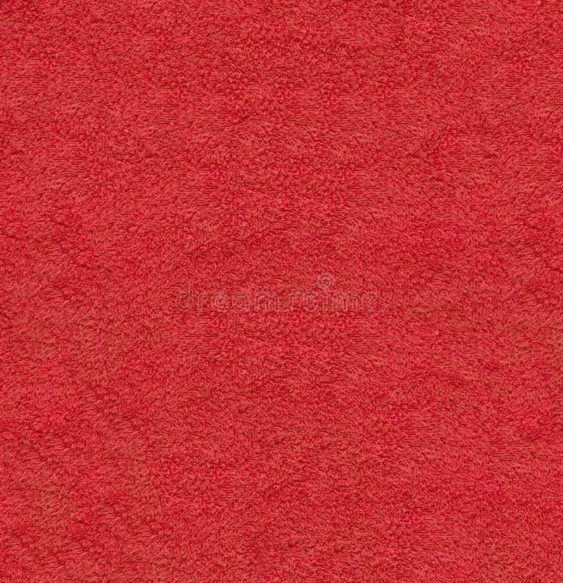 Röd naturlig plysch texturerad textur för closeup för tygmakrobakgrund royaltyfri fotografi