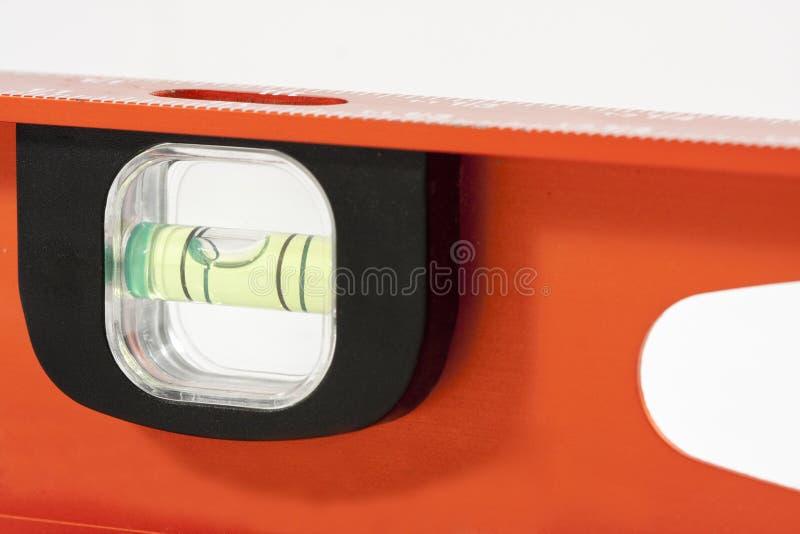 Röd nivå med bubblan fotografering för bildbyråer