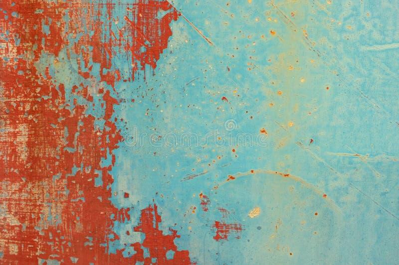Röd och blå metallplatta för Grunge arkivbilder