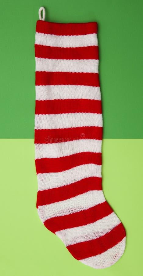 Röd och för vit randig strumpa royaltyfri bild