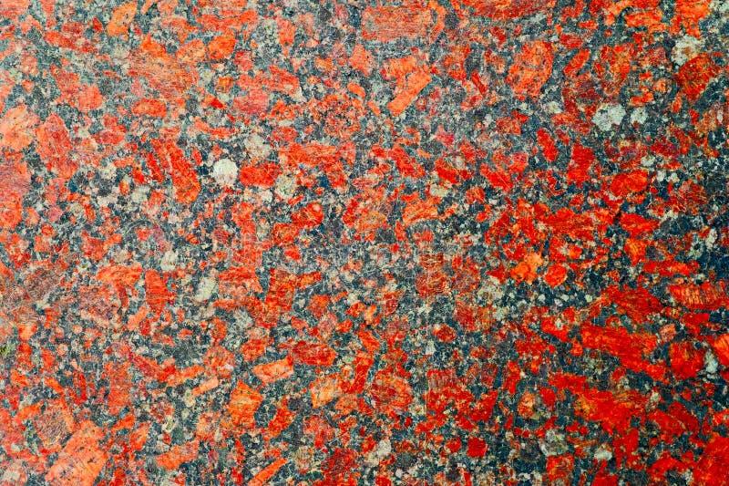 Röd och grå granitbakgrund med härliga nyanser arkivfoto
