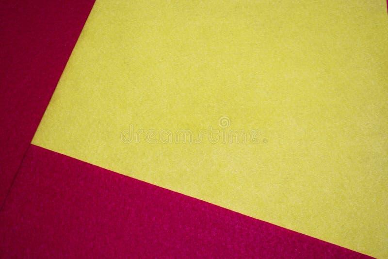Röd och gul tapet för tyg för färgakrylfilt arkivbild