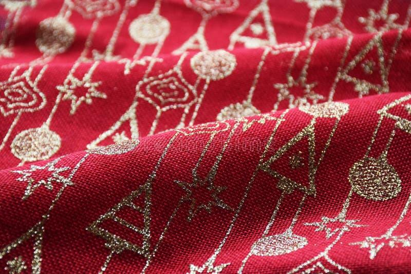 Röd och guld- jul mönstrade materiell bakgrund royaltyfri fotografi