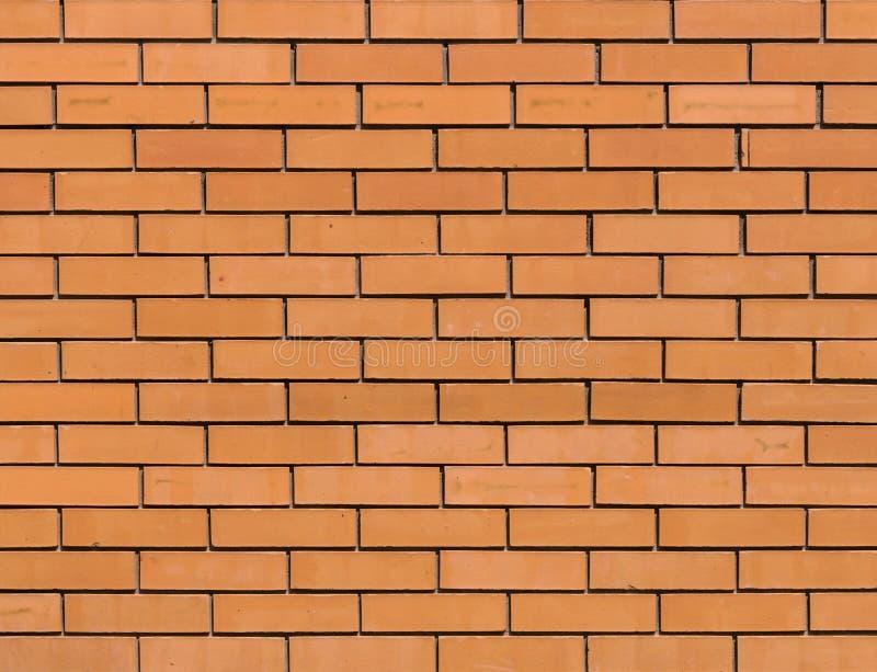Röd orange tegelstenvägg för bakgrundstextur royaltyfri fotografi