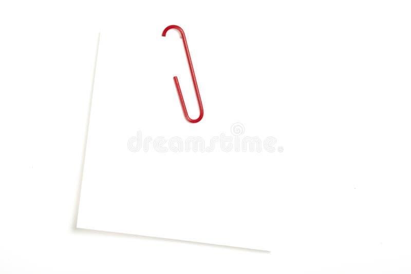 Röd paperclip royaltyfri foto