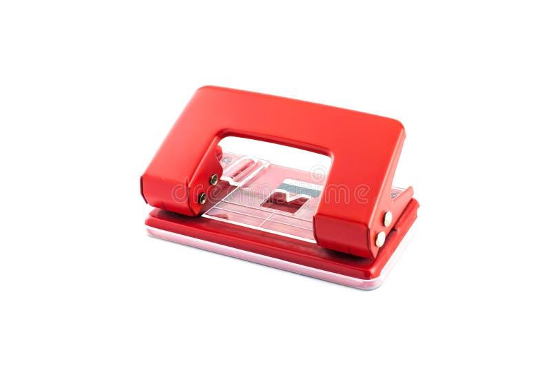 Röd pappers- hålpuncher som isoleras på vit bakgrund royaltyfri bild