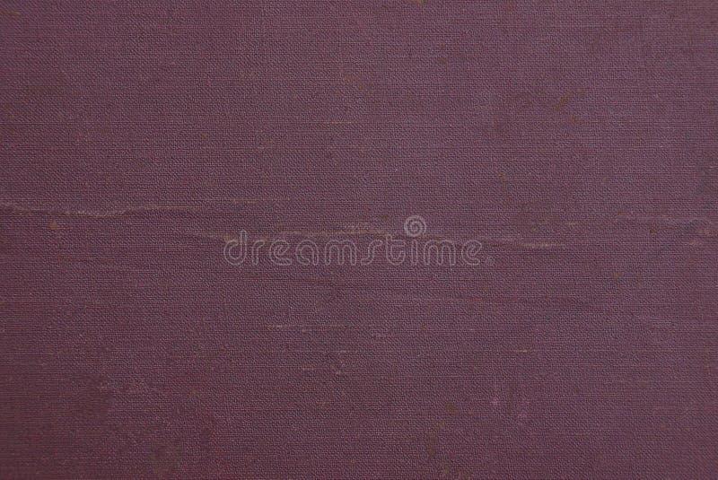 Röd pappers- textur från en gammal papp på räkningen av en bok royaltyfri foto