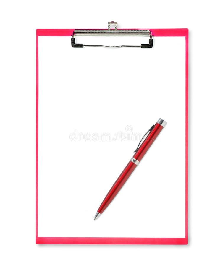 Röd penna på den röda skrivplattan med papper på vit bakgrund royaltyfria foton