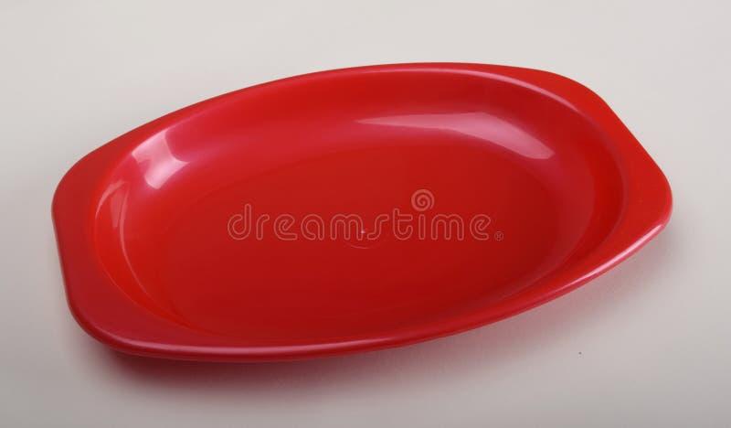 Röd plast- bordsservis royaltyfria bilder