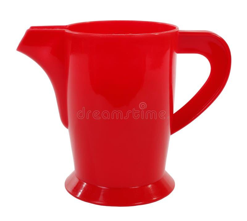 Röd plast- kokkärlkanna arkivfoton