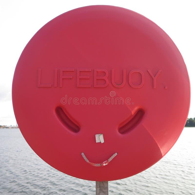 Röd plast- livboj royaltyfri foto