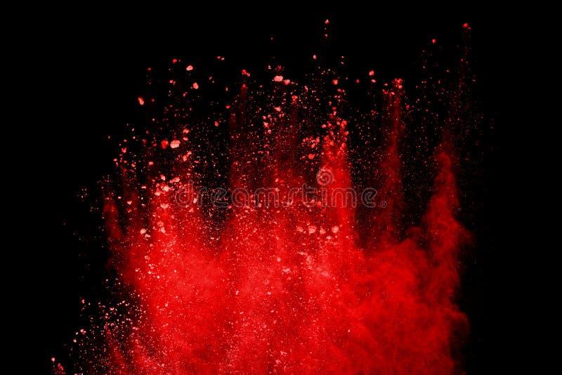 Röd pulverexplosion som isoleras på svart bakgrund fotografering för bildbyråer