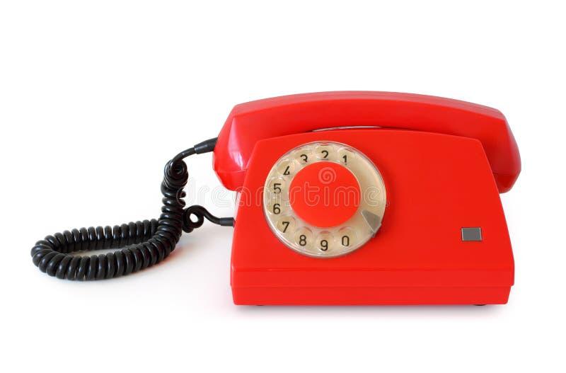 Röd retro roterande telefon arkivbild