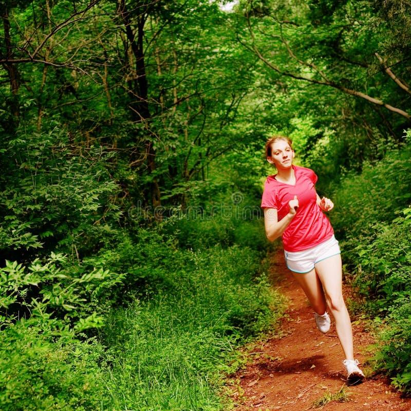 röd running kvinna royaltyfria foton