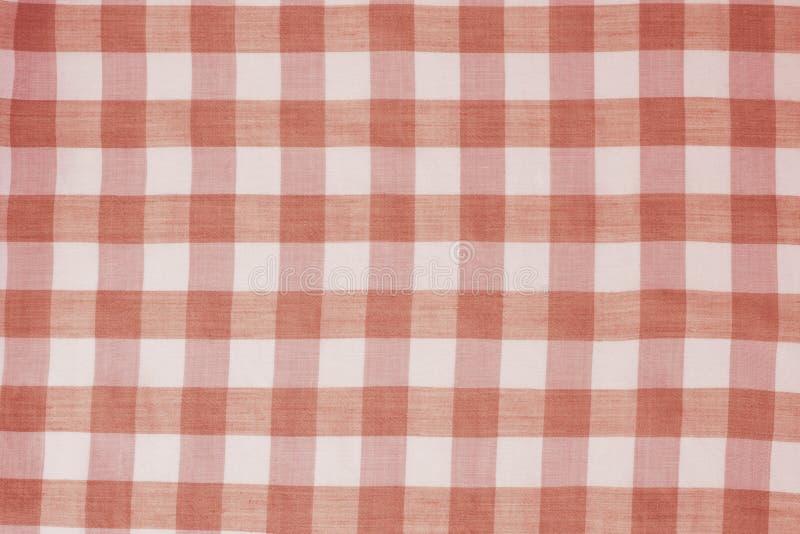 Röd rutig borddukbakgrund arkivfoton