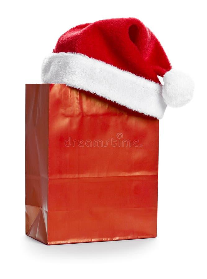 röd s santa shopping för påsehatt royaltyfria foton