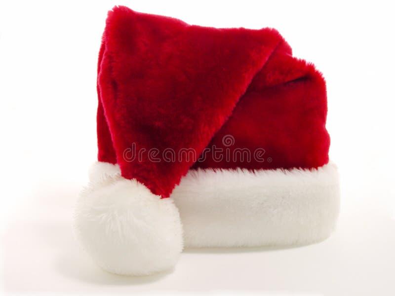 röd santa för hatt white arkivbild