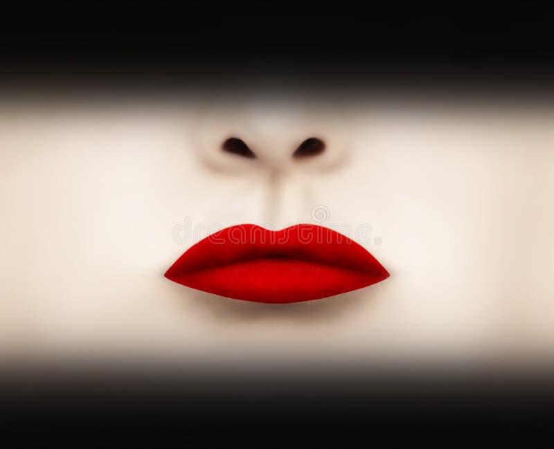 Röd scharlakansröd läppstift royaltyfri foto