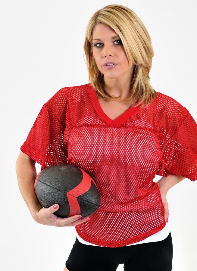 röd sexig kvinna för blont fotbolljersey ingrepp royaltyfri fotografi