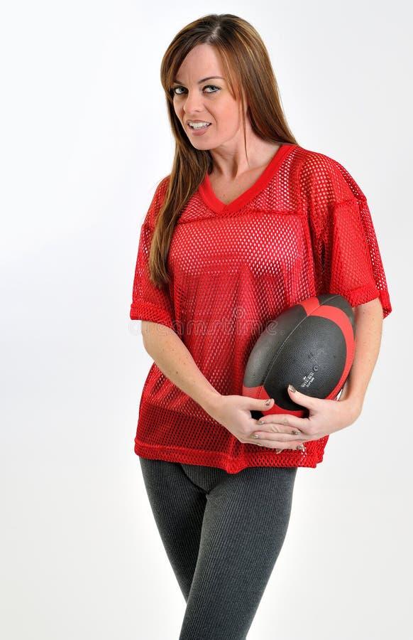 röd sexig kvinna för brunettfotbolljersey ingrepp fotografering för bildbyråer