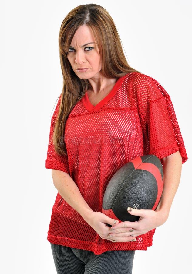 röd sexig kvinna för brunettfotbolljersey ingrepp arkivfoton