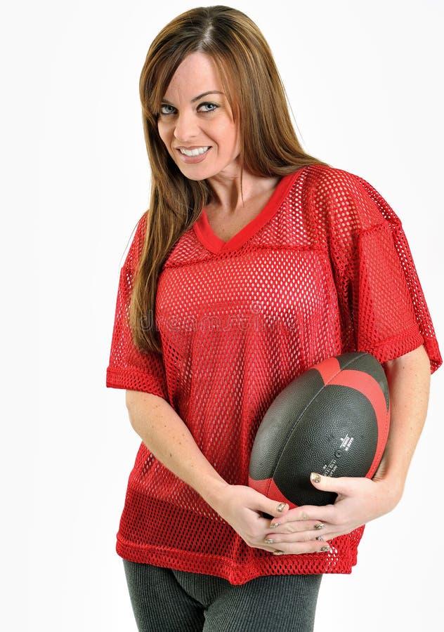 röd sexig kvinna för brunettfotbolljersey ingrepp royaltyfri bild