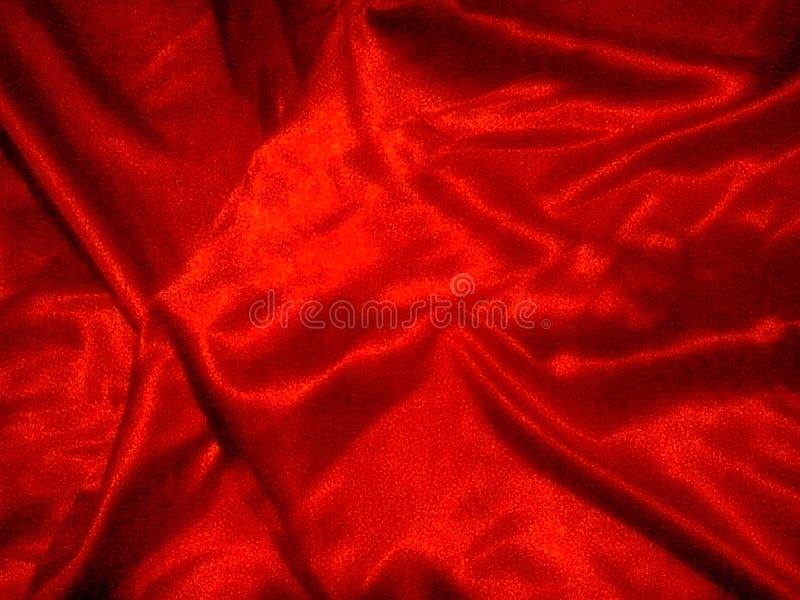 Röd silk bakgrund arkivfoto