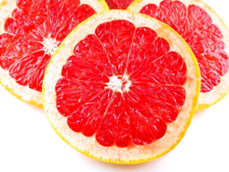 Röd skivad grapefrukt royaltyfria bilder
