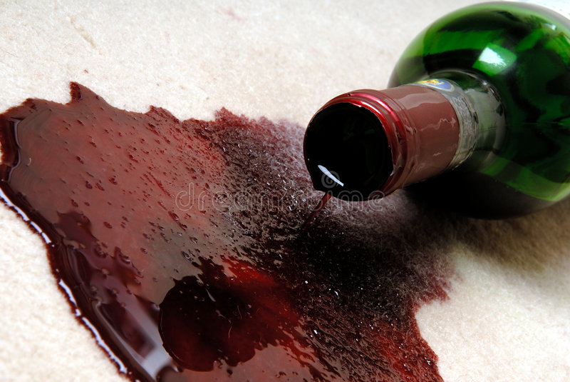 röd spilld wine royaltyfria bilder