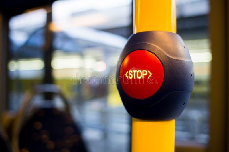 Röd stoppknapp på bussen royaltyfria bilder